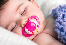 Sleeping Baby With A Pacifier ...