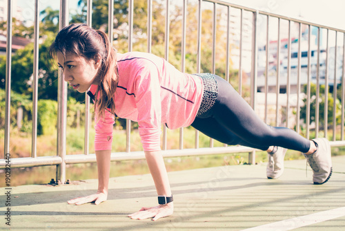 1e1f964cc74a6 Fitness sport girl fashion sportswear doing yoga fitness exercise in  street. Fit young asian woman doing training workout in morning.