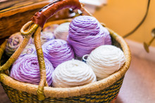 Wooden Basket Filled With White And Purple, Lilac Color Yarn For Knitting Home Hobby Closeup