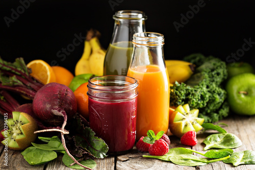 Fotografie, Obraz  Fresh vegetable and fruit juices with beets, berries and greens