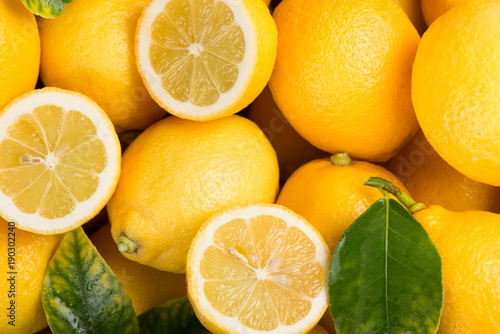 Lemon with leaves  background.