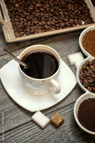Fototapety, obrazy: Drinks, drinking, energy and caffeine concept-coffee cups, coffee beans, ground coffee and instant on a wooden background.