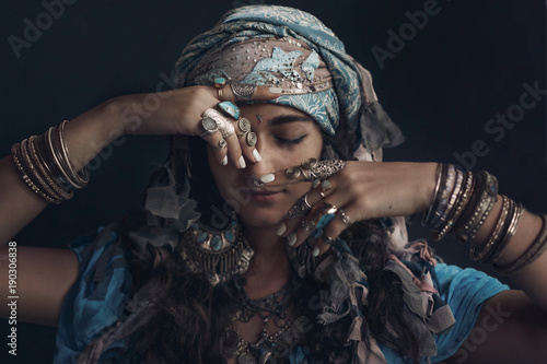 gypsy style young woman wearing tribal jewellery portrait Wallpaper Mural