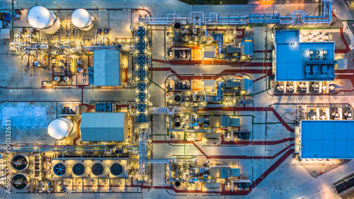 Fototapeta Aerial view petrochemical plant at night, Oil refinery build plant construction at night view from above, Business chemical oil and gas .  obraz