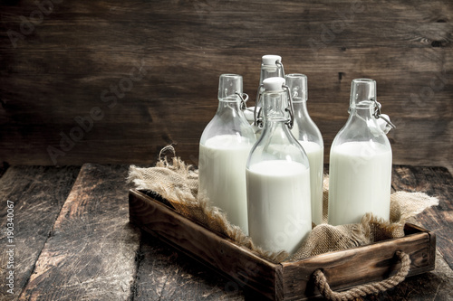 Bottles with fresh milk in a box. Fototapete