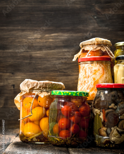 Photo  Preserves vegetables and mushrooms in glass jars.