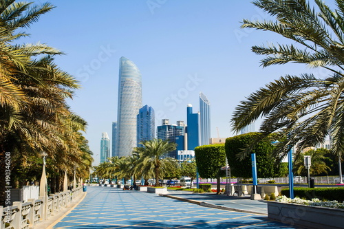 Plagát  Abu Dhabi Corniche walking area with landmark view of modern bui