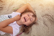 Happy child is laughing at the beach
