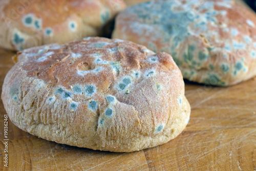 Fotografie, Obraz  Moldy inedible food. Mold on bread rolls.