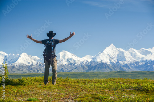Canvas Prints American Famous Place man with outstreched arms in front of Alaskan Range, Denali