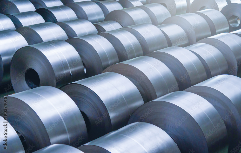 Fototapeta Cold rolled steel coil at storage area in steel industry plant.