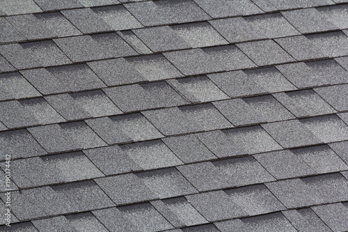 Fototapeta grey and black roof shingles