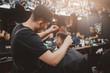 Barber shop. Barber Master does hairdo Barbershop