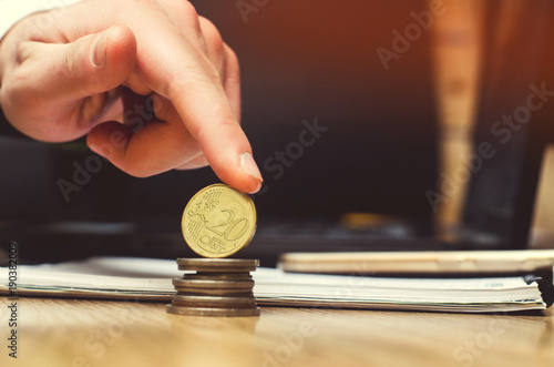 Photographie  save money and investment concept. euro coin