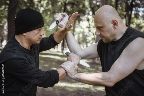Keuken foto achterwand Vechtsport Lameco Astig Combatives. Knife vs knife self defense disarming technique