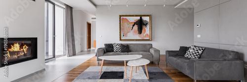Obraz Villa living room with fireplace - fototapety do salonu