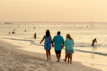 People Walks In The Beautiful Eagle Beach In Aruba.