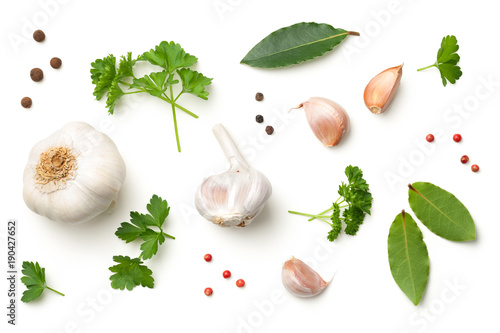 Garlic, Bay Leaves, Parsley, Allspice and Pepper Isolated on White Background