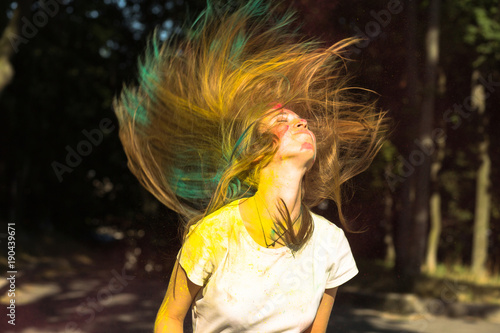 Fototapety, obrazy: Cool young woman with flying hair celebrating Holi festival