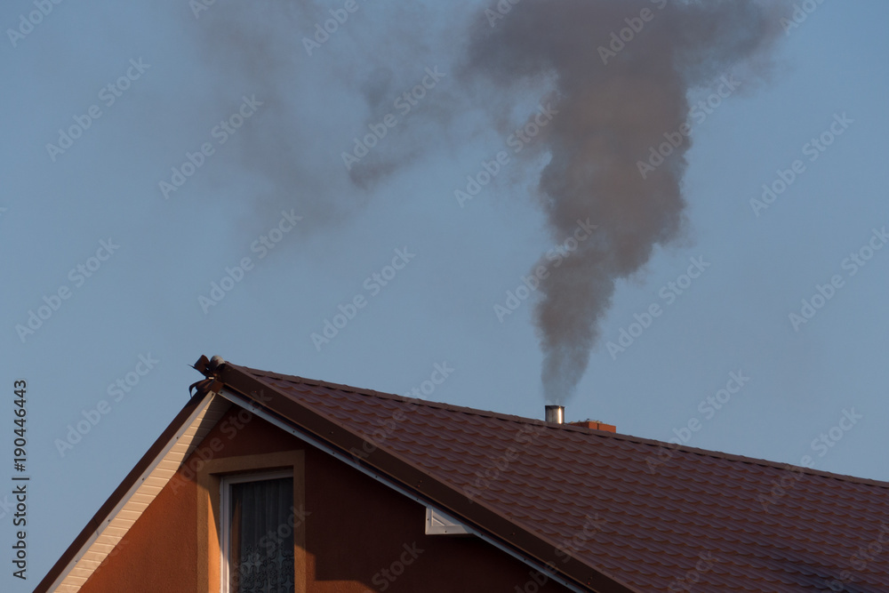 Fototapeta black smoke from the chimney