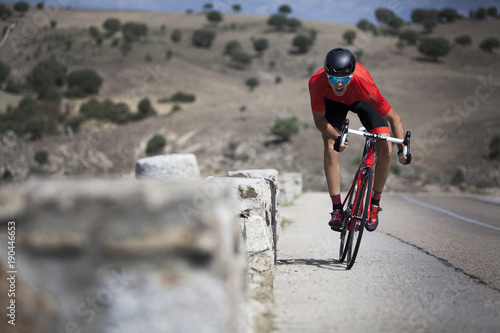 cyclist climbing the road 05