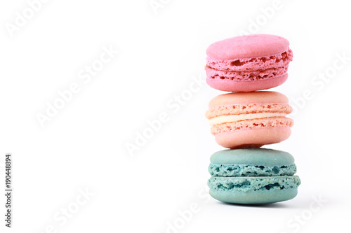 Foto op Plexiglas Macarons Brightly Colored Stacked Up French Macarons on White