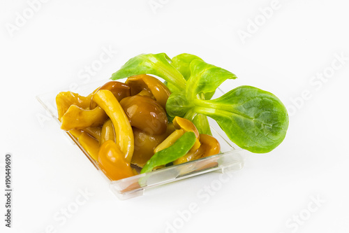 Deurstickers Klaar gerecht Salad snack from marinated mushrooms in a plastic dish