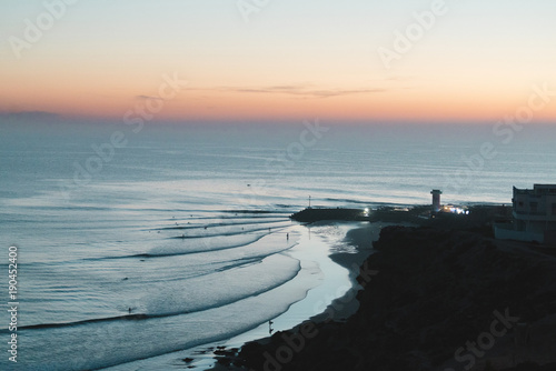 High angle scenic view of sea against sky during sunset