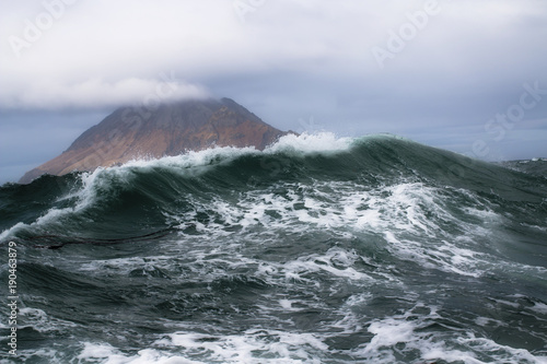 Wall Murals Volcano high storm surge of the Pacific Ocean on the background of the Kuril Islands with rainbow