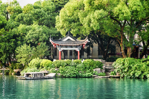 Foto op Canvas Guilin Traditional Chinese pavilion by lake among trees, Guilin
