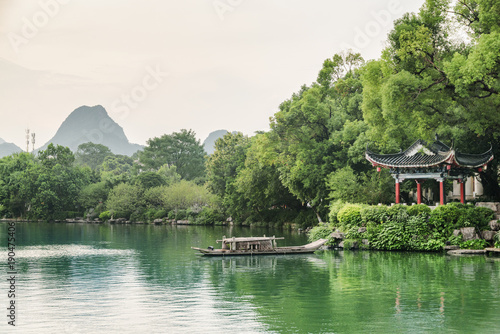 Fotobehang Guilin Evening view of traditional Chinese pavilion by lake, Guilin