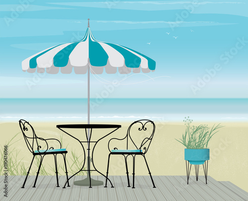 Summer Scene Bistro Table And Pagoda Patio Umbrella On A Breezy Day At The  Beach.