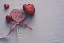 Love You On Heart Shape Prop With Red Hearts And Dead Space On The Right
