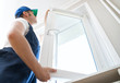 canvas print picture - Professional handyman installing window at home.