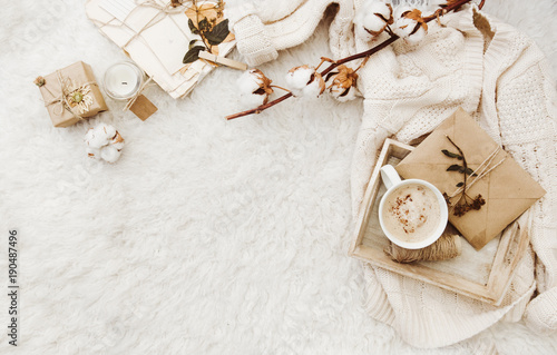 Fototapeta Winter cozy background with cup of coffee, warm sweater and old letters
