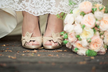Bride's Shoes And Bouquet In Pastel Colors