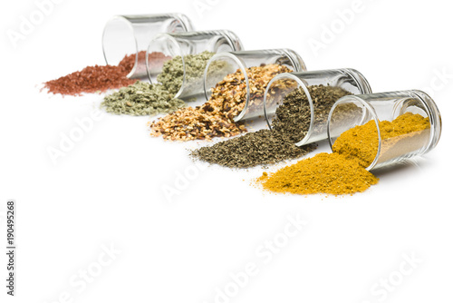 Canvas Prints Spices glass jars with various spices on white background with copy space