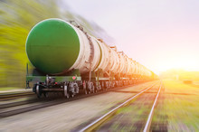 Freight Train Passing Oil-load...