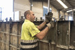 Man adjusting concrete structure in construction factory. Adjusting the mold to create a piece of cement