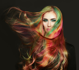 Naklejka Portrait of young beautiful woman with long flowing hair. Model with perfect Healthy Dyed Hair. Rainbow Hairstyles