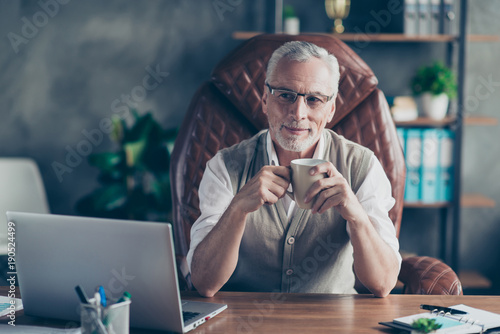 Stampa su Tela Cheerful careless excited joyful old businessman with bristle is pondering about
