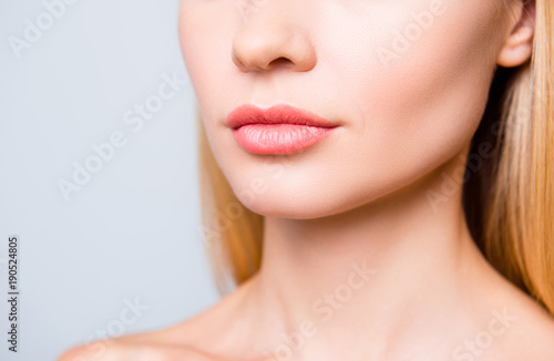 Fotografiet  Close up cropped photo of big natural woman's lips without lipstick and perfect skin