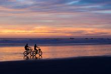 Sunset Bike Ride On The Beach