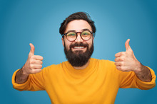 Happy Hipster Gesturing Thumbs Up