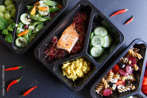 Tuinposter Eten Healthy food and diet concept. Dietary catering. Restaurant dish delivery. Fitness meal. Take away. Fit and eat. Weight loss nutrition in foil boxes.