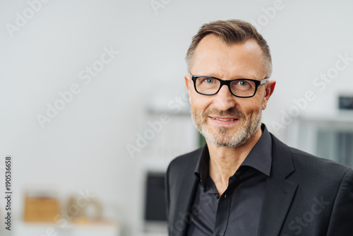 Middle-aged businessman wearing glasses