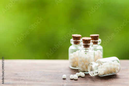Homeopathy pills in vintage bottles Canvas Print