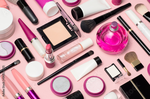 Fotografija  Set of makeup cosmetics, brushes, concealer and other essentials on pink backgro