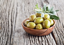 Green Olives On Wooden Board