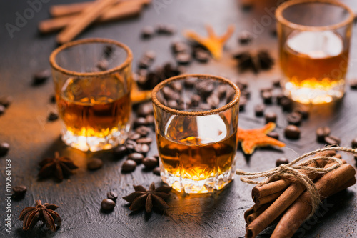 Whiskey, brandy or liquor, spices, anise stars, coffee beans, ci